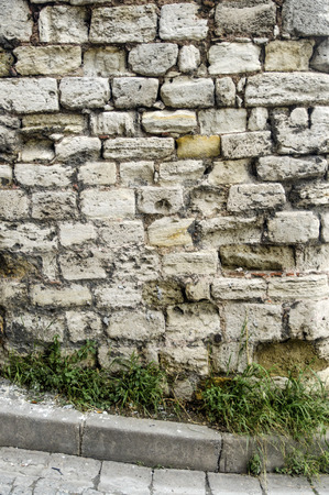 Historical Buildings knit worn stone wall. Background Stok Fotoğraf