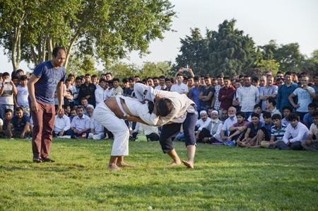 Istanbul, Turkey - July 31, 2016: Central Asian Turkmen wrestling. in Zeytinburnu district of Istanbul, Turkmen wrestling sports events held in the coastal meadows. Turkmen, Uzbek, Afghan, Turkish, Turkmenistan, Kazakhstan, Turkey and other Central Asian  Editorial
