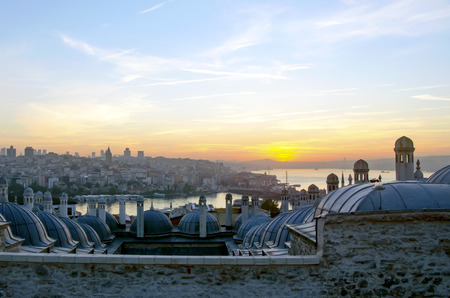 rabi: Sultan Suleiman (Suleymaniye) Madrasah (Rabi). Galata bridge across the Golden Horn and the sunrise view of Istanbul