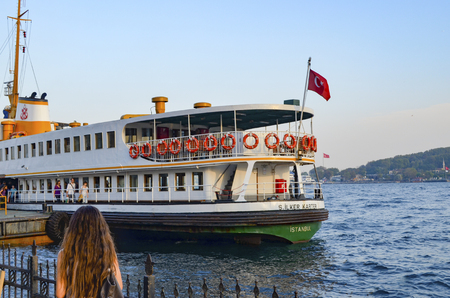 Istanbul, Turkey - October 2, 2012: Ferry in Karakoy pier. Istanbul Ferries continue to serve as a key public transport link for many Thousands of commuters, tourists and vehicles per day.