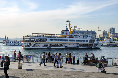 kadikoy: Istanbul, Turkey - May 29, 2016: The centre of Kadikoy today is the transportation hub for people commuting between the Asian side of the city and the European side across the Bosphorus. There is a large bus and minibus terminal next to the ferry docks. F