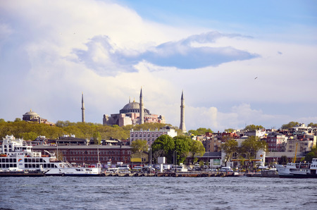 hagia sophia: Istanbul, Turkey - April 18, 2014: Istanbul Ferry and Hagia Sophia Museum. Passenger ferry in Istanbul and it appears in the background Hagia Sophia Museum