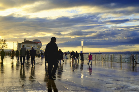 Istanbul, Turkey - January 19, 2013: Rainy Istanbul coast people. Istanbul European Side appears in the background