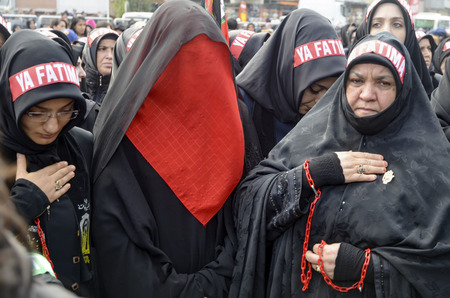 burqa: Istanbul, Turkey - November 3, 2014: Universal Ashura Mourning Ceremony. Day of Ashura. A Universal Ashura Mourn Ceremony, was held in Istanbul to commemorate the martyrdom of Husain ibn Ali, the grandson of the Prophet Muhammad and his 71 friends. Editorial