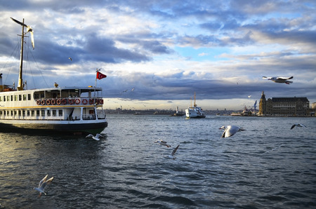 Turkey - Istanbul throat historic Haydarpasa train station and the ferry.  Ferries in Istanbul commuter ferries have been operating on the Bosphorus since 1851. Boats have traversed the waters of the Bosphorus for millennia and until the opening of the fi Stock Photo