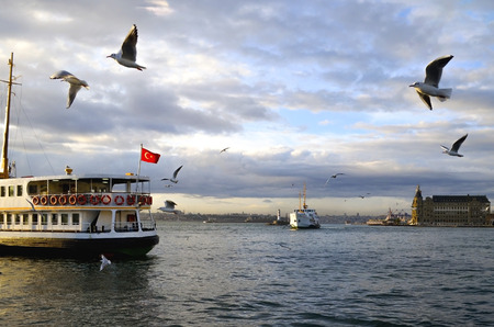Istanbul throat historic Haydarpasa train station and the ferry.  Ferries in Istanbul commuter ferries have been operating on the Bosphorus since 1851. Boats have traversed the waters of the Bosphorus for millennia and until the opening of the first Bosph Stock Photo