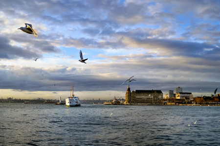 Istanbul, Turkey - January 19, 2013:  Istanbul throat historic Haydarpasa train station and the ferry.  Ferries in Istanbul commuter ferries have been operating on the Bosphorus since 1851. Boats have traversed the waters of the Bosphorus for millennia an Stock Photo