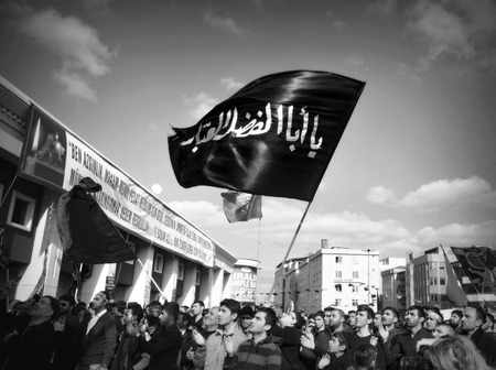 martyrdom: Istanbul, Turkey - November 3, 2014:Mourning of Muharram in Turkey. A Universal Ashura Mourn Ceremony, was held in Istanbul to commemorate the martyrdom of Husain ibn Ali, the grandson of the Prophet Muhammad and his 71 friends.