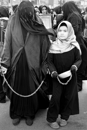 burqa: Istanbul, Turkey - November 3, 2014: Mourning of Muharram in Turkey. A Universal Ashura Mourn Ceremony, was held in Istanbul to commemorate the martyrdom of Husain ibn Ali, the grandson of the Prophet Muhammad and his 71 friends.