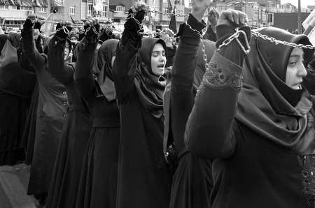 martyrdom: Istanbul, Turkey - November 3, 2014: Mourning of Muharram in Turkey. A Universal Ashura Mourn Ceremony, was held in Istanbul to commemorate the martyrdom of Husain ibn Ali, the grandson of the Prophet Muhammad and his 71 friends.