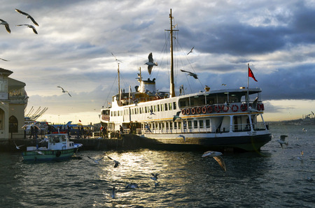 Istanbul, Turkey - January 19, 2013:  Ferries in Istanbul. Boats have traversed the waters of the Bosphorus for millennia and until the opening of the first Bosphorus bridge in 1973, were the only mode of transport between the European and Asian halves of