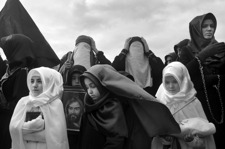 martyrdom: Istanbul, Turkey - November 3, 2014: Ashura Mourning, sad people at the event. Day of Ashura. A Universal Ashura Mourn Ceremony, was held in Istanbul to commemorate the martyrdom of Husain ibn Ali, the grandson of the Prophet Muhammad and his 71 friends. Editorial