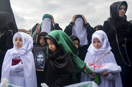 martyrdom: Istanbul, Turkey - November 3, 2014: Mourning of Muharram in Turkey. Day of Ashura. A Universal Ashura Mourn Ceremony, was held in Istanbul to commemorate the martyrdom of Husain ibn Ali, the grandson of the Prophet Muhammad and his 71 friends.