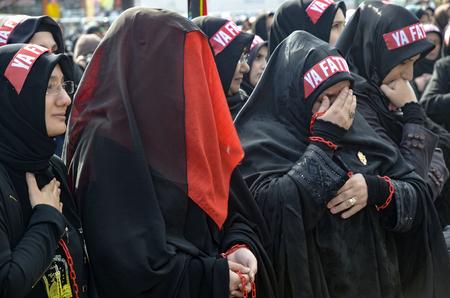 burqa: Istanbul, Turkey - November 3, 2014: Universal Ashura Mourning Ceremony. Day of Ashura. Turkish Shia women mourn during an Ashura procession. A Universal Ashura Mourn Ceremony, was held in Istanbul to commemorate the martyrdom of Husain ibn Ali, the grand