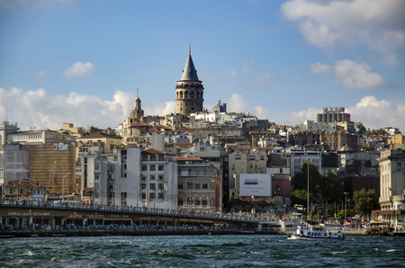 Istanbul, Turkey - July 26, 2016: Galata Bridge and Galata Tower in the background, Istanbul views. This is a great place to see the colors of Istanbul at . Interesting to see the fishermen on the bridge with the Galata tower in the background. There are