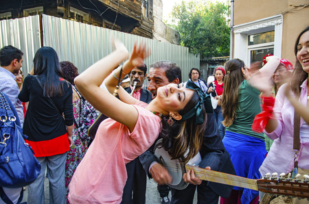 nb: Istanbul, Turkey - May 05, 2013: Hidrellez in Ahirkapi Festival (Romani language: Ederlezi) People dancing on the streets. Hidrellez is one of the seasonal festivals of all Turkish world which is celebrated as the first day of the early summer. It is also Editorial