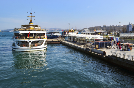 Istanbul, Turkey - March 29, 2013:  Istanbul Ferries, Eminonu waiting in the harbor.  (called vapur in Turkish) continue to serve as a key public transport link for many Thousands of commuters, tourists and vehicles per day. Editorial