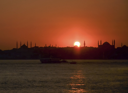 Sunset Istanbul scene. Hagia Sophia in the right part of the photo. In the left section Blue Mosque (Sultan Ahmed Mosque)  silhouette. Stok Fotoğraf