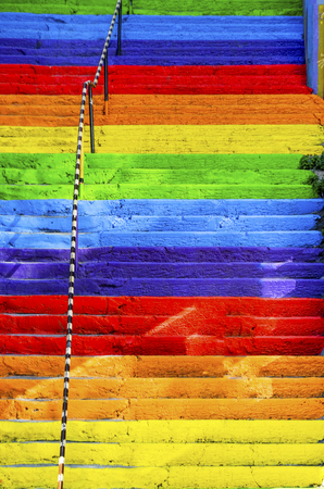 The concrete stairs on the street are painted in rainbow colors. Background Stok Fotoğraf