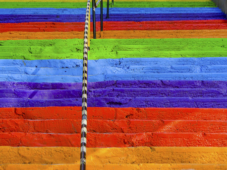Steps rainbow painted street concrete stairs, background.