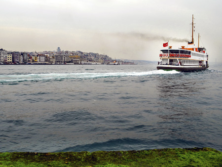 Ferry in Istanbul Bosphorus. Most Istanbulites commute from Europe to Asia on one of the dozen ferries that crisscross the Bosphorus all day long. Stok Fotoğraf