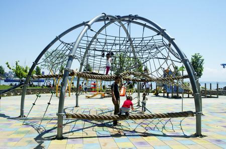 Istanbul, Turkey - May 29, 2016: Public Children playground, Istanbul Kadikoy district beach. Combination playground structure for small children; slides, climbers (stairs in this case), playground.