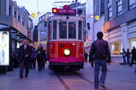 municipal utilities: Istanbul, Turkey - March 12, 2013: Historic tram on Istiklal Avenue.Istiklal Avenue in the Beyoglu district of Istanbul. The former tram on Istiklal Street in Istanbul, Taksim-Tunel carry passengers. Editorial