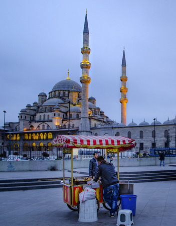 Istanbul, Turkey - March 14, 2013: New Mosque (Yeni Cami), Istanbul, Turkey. The Yeni Cami , originally named the Valide Sultan Mosque and later New Valide Sultan Mosque after its partial reconstruction and completion between 1660 and 1665, is an Ottoman