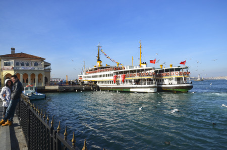 kadikoy: Istanbul, Turkey - February 2, 2014: Old Kadikoy Ferry Pier and Istanbul Ferries (called vapur in Turkish) continue to serve as a key public transport link for many Thousands of commuters, tourists and vehicles per day.