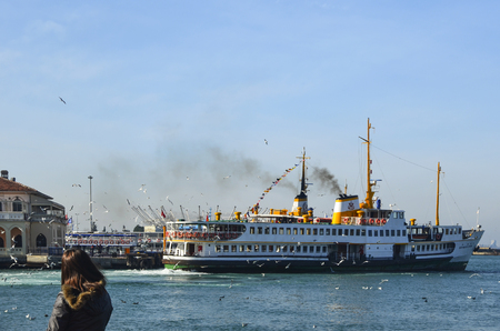Istanbul, Turkey - February 2, 2014: Old Kadikoy Ferry Pier and Istanbul Ferries (called vapur in Turkish) continue to serve as a key public transport link for many Thousands of commuters, tourists and vehicles per day.