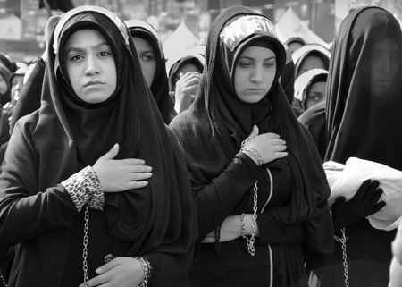 Istanbul, Turkey - October 11, 2016: Shia Muslim women mourn during Ashura. Turkish Shia Muslims mourning for Imam Hussain. Caferis take part in a mourning procession marking the day of Ashura in Istanbuls Kucukcekmece district, Turkey on October 11, 201 Editöryel