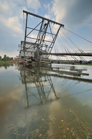 dredger: Abandoned Dredger At Perak, Malaysia. FrontVertical View.