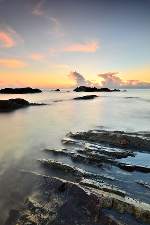 Long exposure shot of seascape during sunrise.