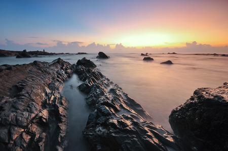 Beautiful long exposure shot of seascape during sunrise.