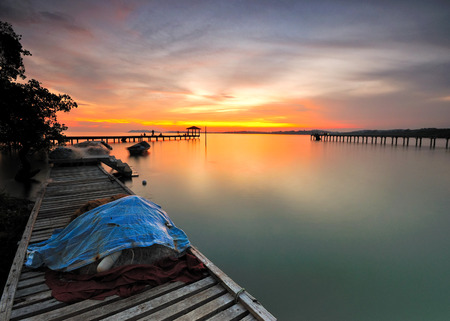 Sunset scenery over the long wooden jetty.