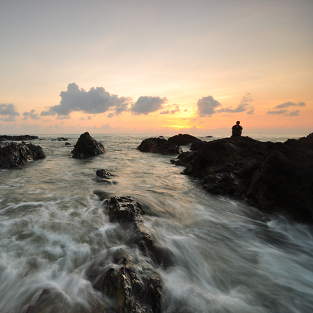 Beautiful sunrise at seascape with motion wave at foreground. Stock fotó