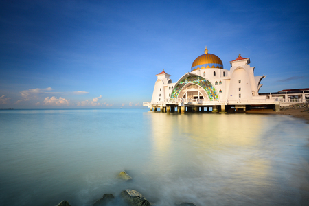 Beautiful majestic floating mosque on blue sky background.