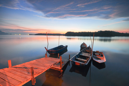 Scenic of blue hour at fishermen village with fishermen boats. Stock fotó