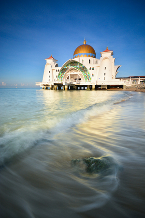 Majestic floating mosque over the blue sky background. Stock fotó