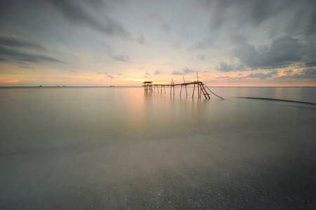 Beautiful long exposure shot of seascape. Old pier background.