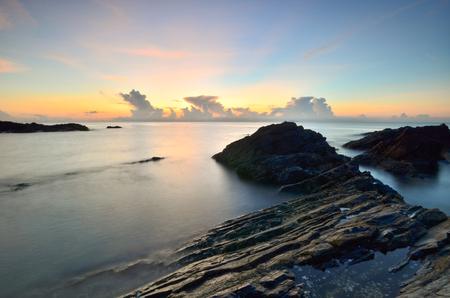 Long exposure shot of seascape at sunrise.