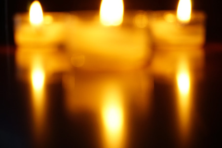 Blurred candles light flame background. Stock fotó