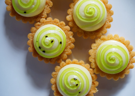 High angle view of delicious cheese tart on white plate.