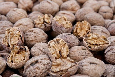 Brown raw walnuts textured background photo