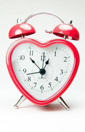 Heart shaped red alarm clock photo