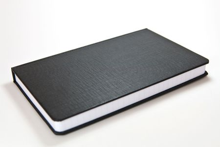 black notebook with blank cover photo