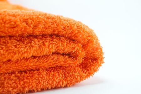 orange washcloth: orange towel on white background  Stock Photo