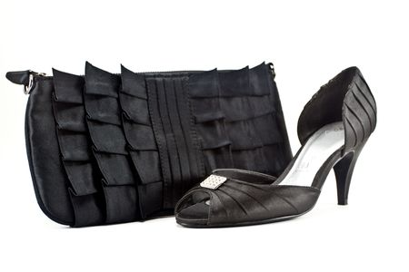 heel strap: Composition of pair footwear and bag Stock Photo