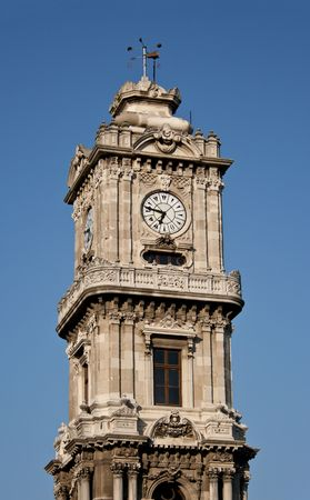 Clocktower of Dolmabahce Palace in Istanbul, Turkey photo