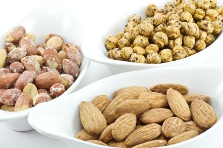 Various nuts; peanuts, almond, roasted chickpeas photo